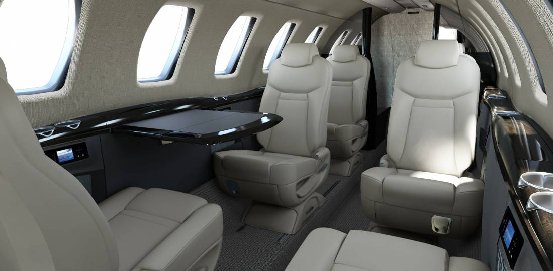 The cabin layout fits either eight or nine passenger seats, including the belted lav.