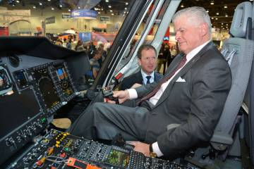 Euroopter Group President & CEO  Lutz Bertling with  Bristow President Bill Chilles inside a EC175 display.